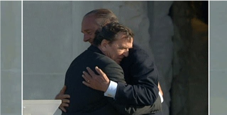 Image of French President Jacques Chirac and German Chancellor Gerhard Schröder embracing at the Mémorial de Caen.
